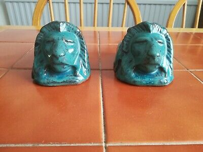Terracotta Sash Window Props/stoppers in the shape of Lions. Some ware.
