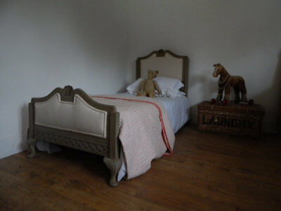 Antique single bed with new upholstery