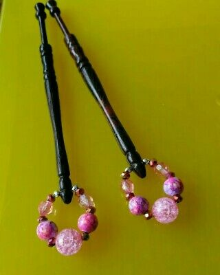 A Pair of Wood Turned Lace Bobbins with Pink Spangles.