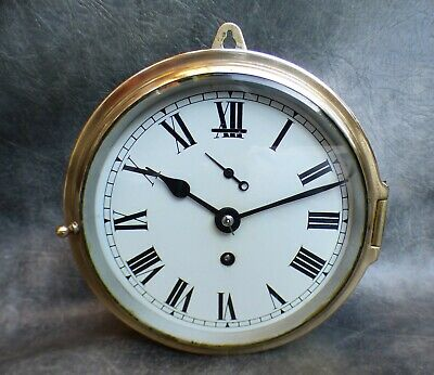 A Good Working Brass Ships Bulkead Clock With 8 Day Empire Movement * Re Oiled *