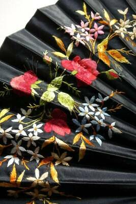 Antique or vintage large black silk folding fan hand embroidered with roses.