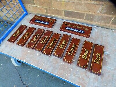 A Selection Of Hanging Wooden Carvery Meat Display Boards