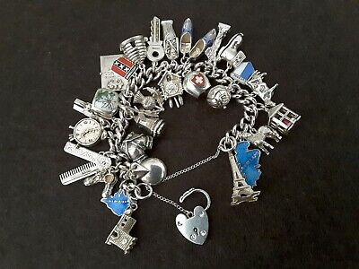 Vintage Silver charm bracelet.. with 28 lovely Charms, some Moveable, (99.5 g)