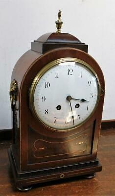 pretty french mahogany brass inlaid striking bracket clock