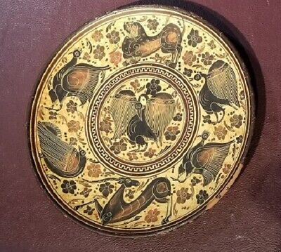 Greek terra cotta plate, richly decorated w/ lion, antelope and birds