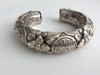 Fine antique Chinese Qing carved silver bracelet with Shou symbol, Lotus