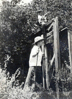 1918 Boy Sits atop Fence Points gun to Shoot Mom Walking stick look out