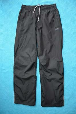 NIKE Black Track pants. Size M. Side Pockets. Grey Trim. New without Tags.