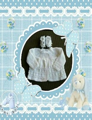 Pretty 3ply white matinee jacket and Mary Jane slippers.000