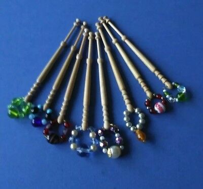 8 Light Wooden Lace Bobbins with Spangles
