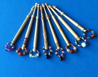 8 Light Wooden Turned Lace Bobbins with Spangles.