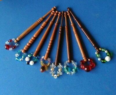 8 Wooden Turned Lace Bobbins with Crystal Spangles.