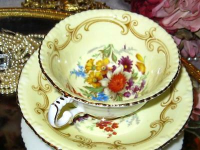 Paragon Yellow Teacup & Saucer Floral Center Fancy Footed Double Warrant