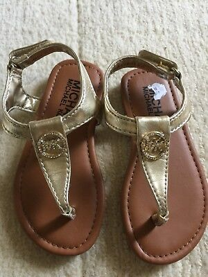 d82164dda1b5 MICHAEL KORS MK PLATE Gold METALLIC LEATHER THONG FLAT SANDALS Baby Size 7