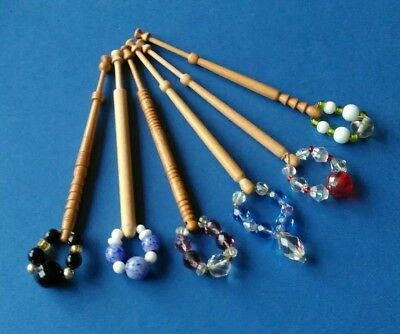 6 Light Wooden Lace Bobbins With Spangles.