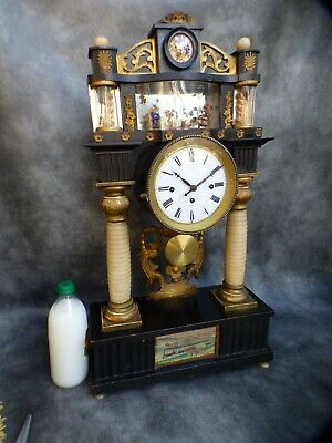 A GOOD SUDRA IN WEIN 30 HOUR QUARTER GONG STRIKE AND MUSICAL PORTICO CLOCK c1860