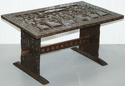 Hand Carved African Dining Table With Decorative Benin Figures Matching Chairs