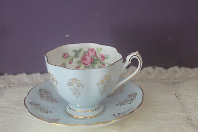 Queen Anne Pale Blue Tea Cup And Saucer With Gold And Rose Spray Inside