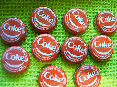 """Lot of  10  THAILAND  COKE Bottle tops/caps. Used...""""Smiley"""" top."""