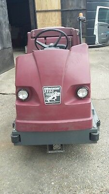 Minuteman 3880 ride on cylindrical scrubber dryer c/w batteries and charger.