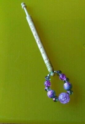 "Bovine Bone Lace Bobbin with ""Fanny"" on Shank with Purple Spangles."