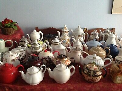 An assortment of vintage china teapots/coffee pots