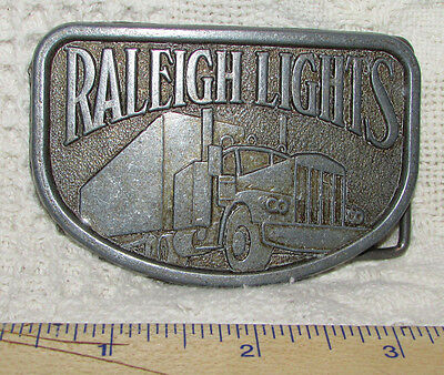 BELT BUCKLE Metal RALEIGH LIGHTS Cigarettes w SEMI TRUCK Relief Image VINTAGE