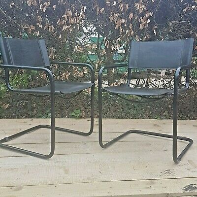 2 vintage leather cantilever   dining chairs by Mart Stam for  Fasem Italy 1988