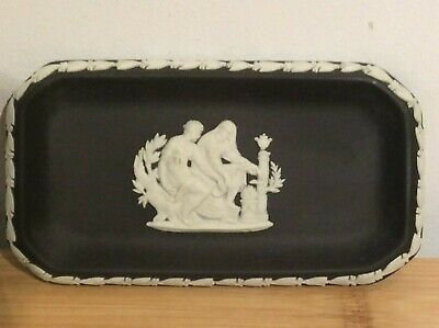 "Wedgwood Black Jasper Ware pin tray 5.5"" by 3"" with 2 male figures in white."