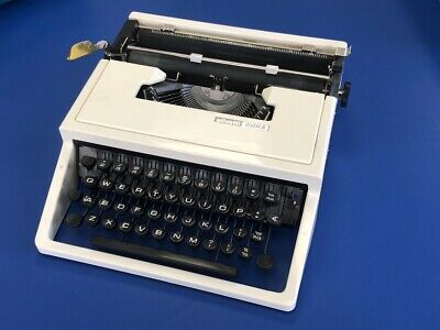1970s Olivetti Dora Typewriter In White With Carry Case