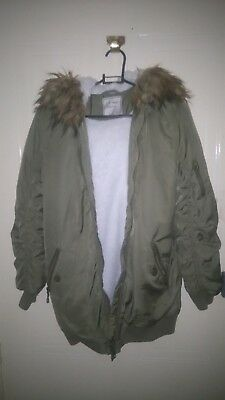 Next girls bomber jacket Green front zip and pockets faux fur hood age 12