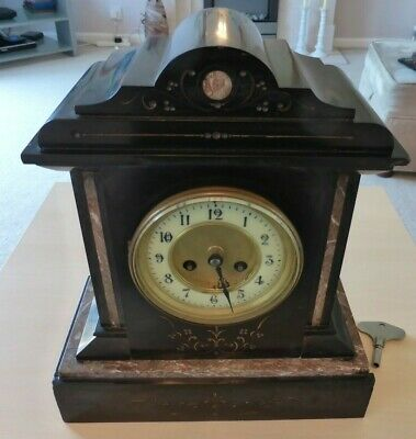 Antique, possibly French, black slate and marble mantle clock, working.