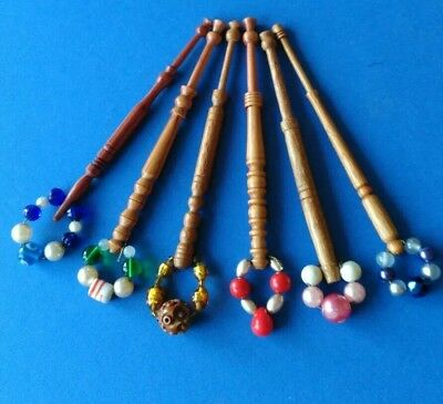 6 Medium Brown Turned Lace Bobbins with Spangles.