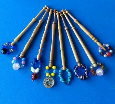 8 Wooden Turned Lace Bobbins with Spangles.