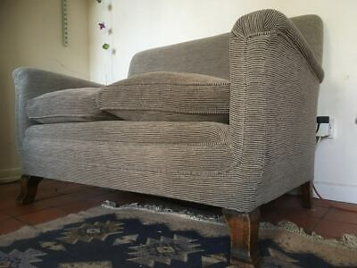 Small vintage two seater sofa.