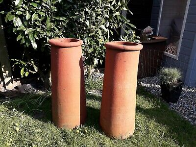 Pair of tall roll-top vintage clay/terracotta chimney pot