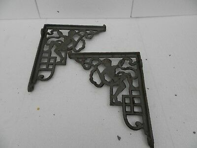 pair cast iron wall brackets with cherubs on 11 by 9 inch prima coated