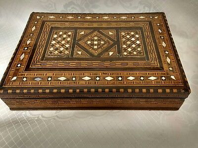 Vintage parquetry box inlaid with Mother of Pearl and a variety of woods