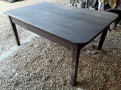 Old rustic wooden farm house table.
