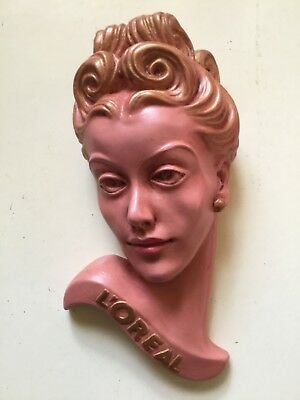 Large deco style wall mask plaque,chalkware L?Oréal advertising plaque / pink