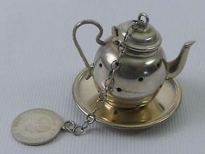 (ref165EP 5) Unusual silver teapot infuser tray and coin on chain