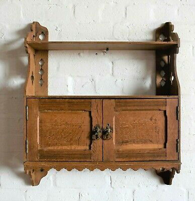 Antique vintage oak wall hanging display shelf with cupboard