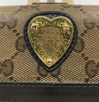 66b345a4a593 Gucci GG Logo Coated Canvas Long Wallet With GUCCI CREST Leather Trimmed