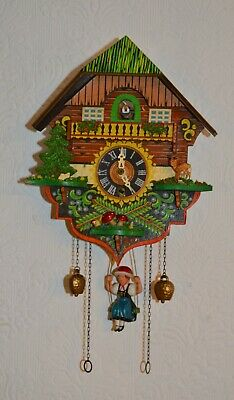 A Good Working Chalet Style Cuckoo Clock With Forward Swinging Girl Pendulum