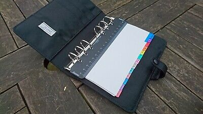 Black filofax college personal size with some inserts and dividers