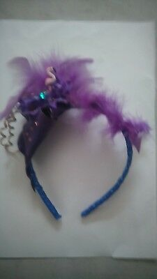 Purple headband fasinator with feathers/flamingo