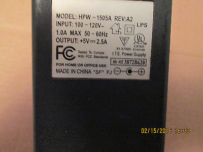 A C ADAPTER MODEL HP1505A REVA2 IN100-240V/1.0A/50/60Hz OUT 5V/2.5A