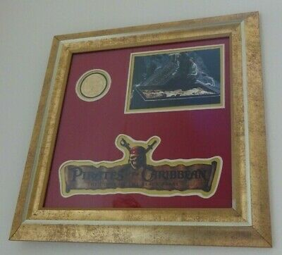 Pirates Of The Carribean Production Gold Coin (used on film) in Framed Display