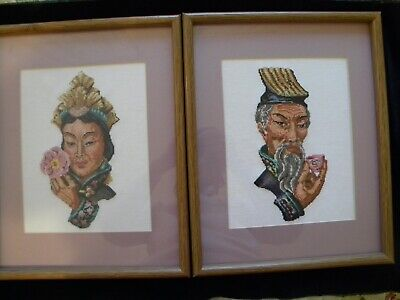 2 completed framed cross stitch pictures of oriental man and woman. 1988