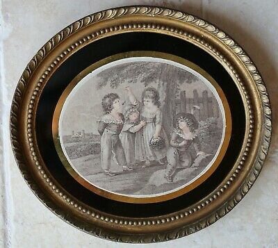Pair of antique mezotints of children playing in original oval gilt frames